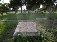Mattie Barnfield Hackworth's grave marker with view of Mountain Peak Cemetery