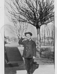 Frederick William Bonifield as a boy in a uniform in 1919