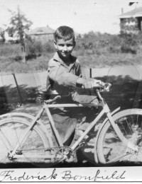 Frederick William Bonifield as a boy with a bike