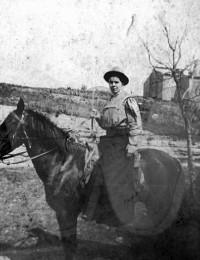 Cornie (Overby) Irvin on horseback
